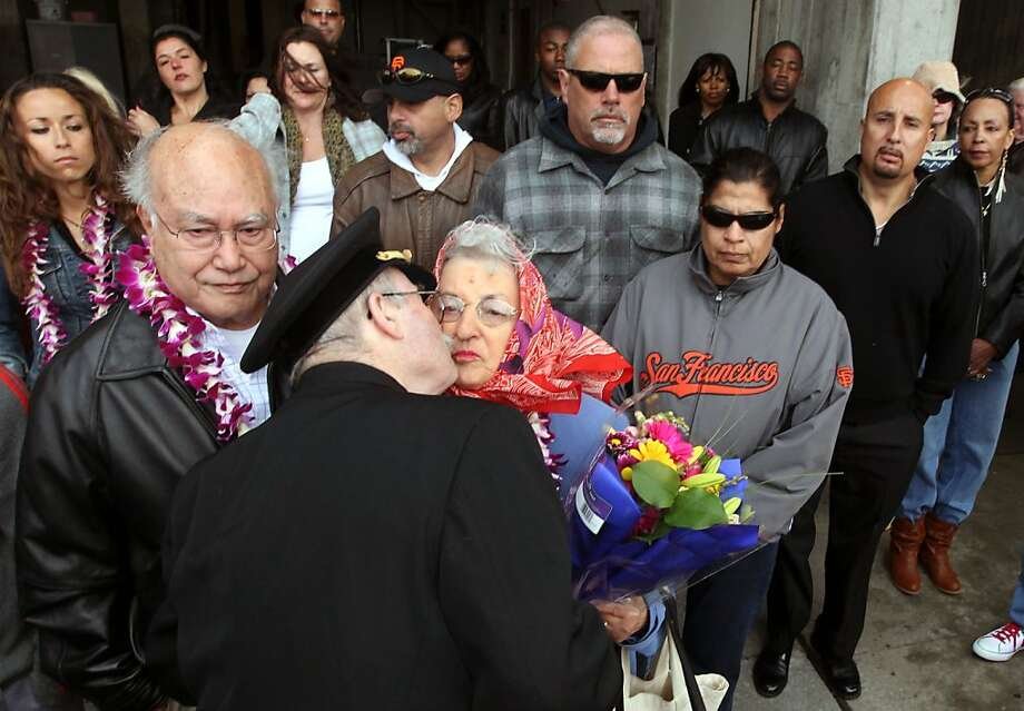 Father John Greene of the San Francisco Fire Department greets Frank and Lorene Valerio at station 26. The couple lost their son Anthony Valerio one year ago along with Lieutenant Vincent Perez as the two firefighters were killed in a San Francisco house fire. Members of the department and community gathered for a moment of silence that was observed at 10:58 AM the time of there passing Saturday June 2, 2012. Photo: Lance Iversen, The Chronicle