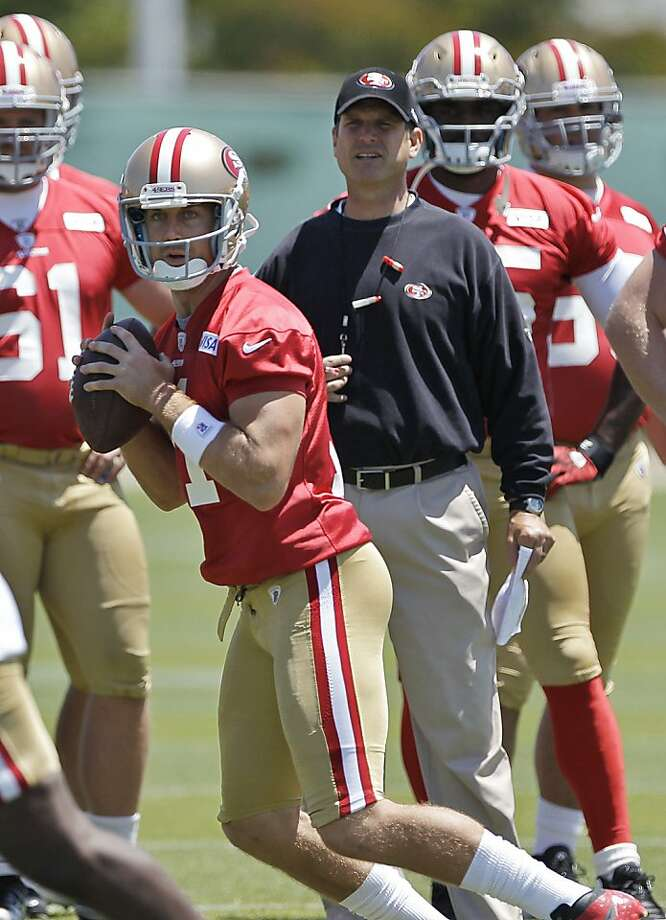 San Francisco 49ers quarterback Alex Smith prepares to pass as coach Jim Harbaugh watches during NFL football practice in Santa Clara, Calif., Wednesday, May 23, 2012. (AP Photo/Paul Sakuma) Photo: Paul Sakuma, Associated Press
