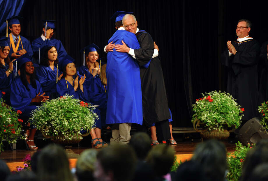 Jay Katz hugs his grandson David Katz after presenting him with his diploma, during Christian Heritage School's 29th Annual Commencement Exercises in Trumbull, Conn. on Saturday June 2, 2012. Jay Katz was headmaster at the school from 1976 to 1981. Photo: Christian Abraham / Connecticut Post