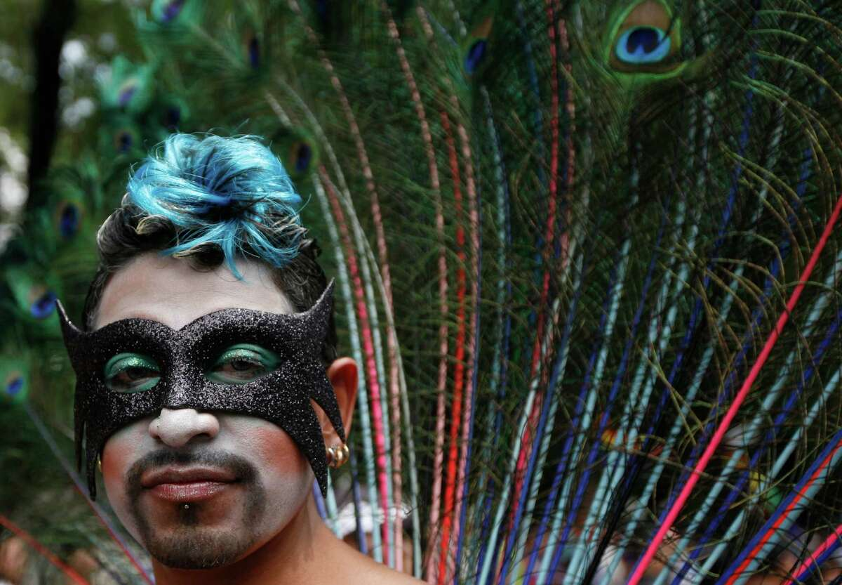A person in costume pauses for a portrait during a gay pride parade in Mexico City, Saturday, June 2, 2012.
