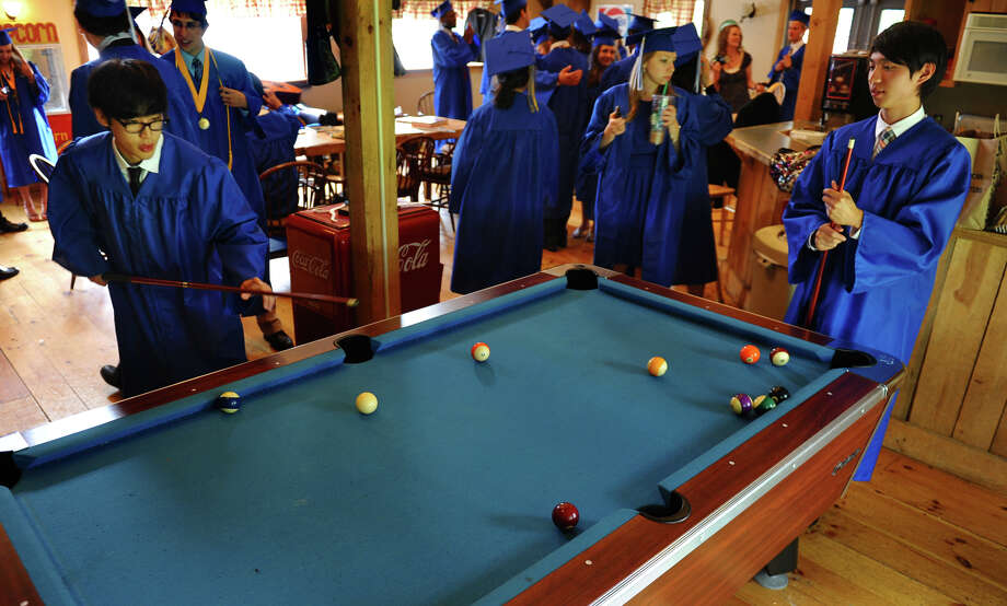 Soon-to-be graduates Ed Lee, left, and Shawn Yoon, play a quick game of pool before the start of Christian Heritage School's 29th Annual Commencement Exercises in Trumbull, Conn. on Saturday June 2, 2012. Photo: Christian Abraham / Connecticut Post