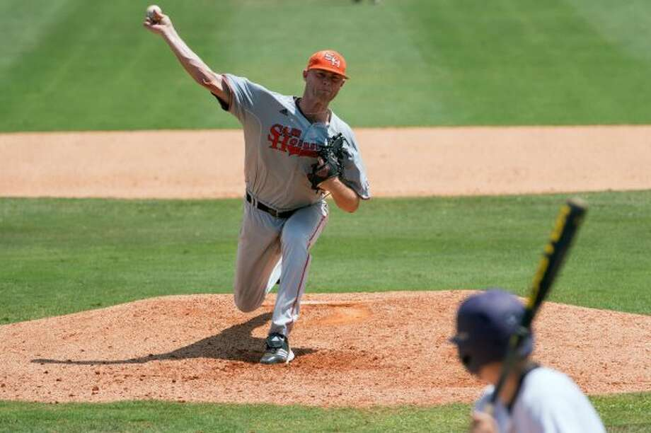 Sam Houston State pitcher Justin Jackson (31) delivers a pitch during the eighth inning of an NCAA college baseball tournament regional game Saturday, June 2, 2012, in Houston. Jackson gave up two runs in eight innings work in the Bearkats 4-2 victory. ( Smiley N. Pool / Houston Chronicle ) (Smiley N. Pool / Houston Chronicle)