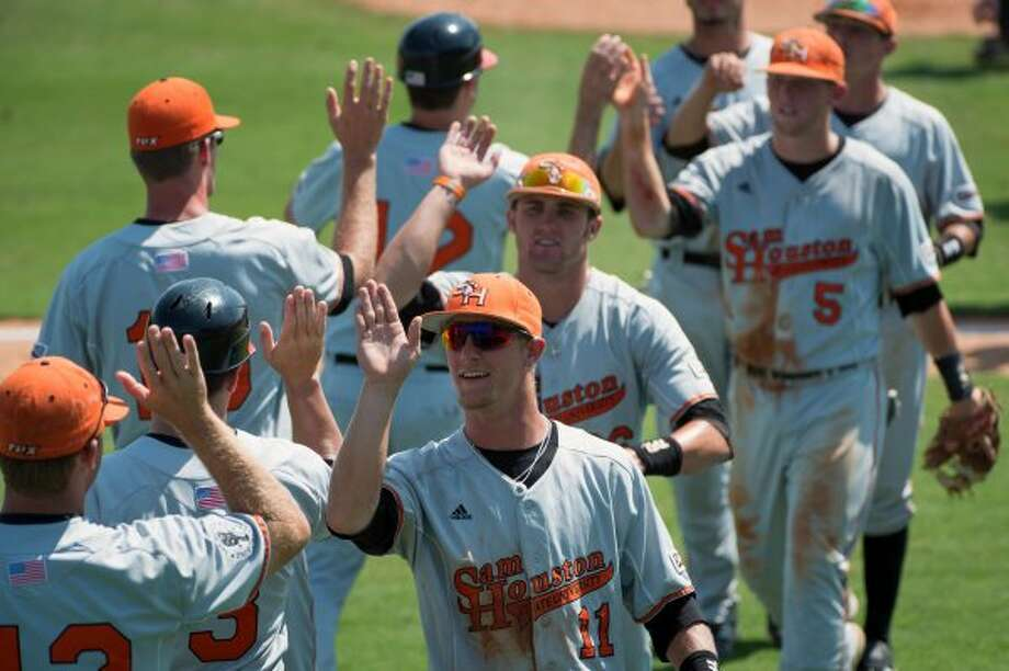 Sam Houston State outfielder Colt Atwood (11) celebrates with teammates after a win over Prairie View in an NCAA college baseball tournament regional game Saturday, June 2, 2012, in Houston. Atwood drove in three runs for the Bearkats in the 4-2 victory. ( Smiley N. Pool / Houston Chronicle ) (Smiley N. Pool / Houston Chronicle)