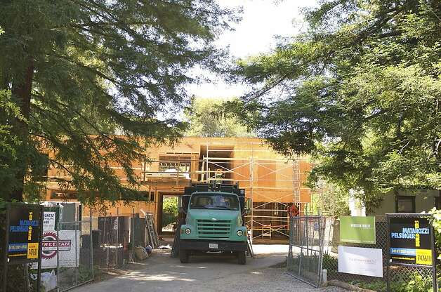 A truck sits in front of a house under construction on San Mateo Drive in the Willows neighborhood of Menlo Park, California, U.S., on Tuesday, May 22, 2012. Facebook Inc.'s Silicon Valley hometown has a limited supply of real estate available for its newly minted millionaires as sellers await further price gains in a market buoyed by growing wealth from technology businesses. Photographer: David Paul Morris/Bloomberg Photo: David Paul Morris, Bloomberg