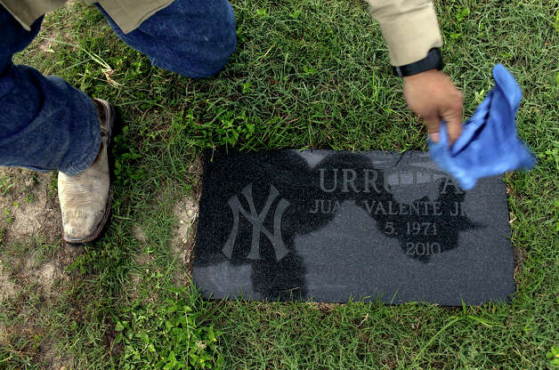 John Garcez cleans the grave of his brother-in-law and best friend, Juan Urrutia, who was killed when Jacob Perez, who was drunk and driving the wrong way on U.S. 90, hit their car, which Garcez was driving and Urrutia was a passenger in, in San Antonio on Saturday May 19, 2012. Garcez visits Urrutia's grave at least once a week. Photo: Lisa Krantz, San Antonio Express-News / San Antonio Express-News