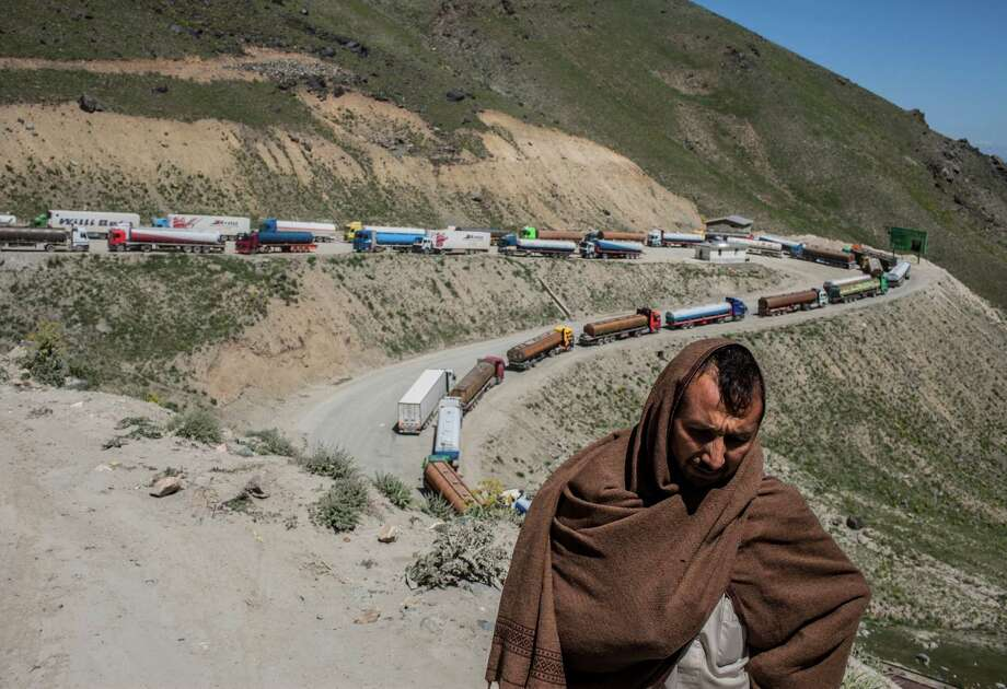 A truck driver waits to cross through the Salang Pass tunnel, which is part of an overland route for supply convoys to reach Kabul and the rest of Afghanistan. Pakistan's ban on NATO truck traffic to protest a deadly American airstrike has increased demand on Afghanistan's sketchy infrastructure everywhere, and on one tunnel in particular. Photo: BRYAN DENTON / NYTNS