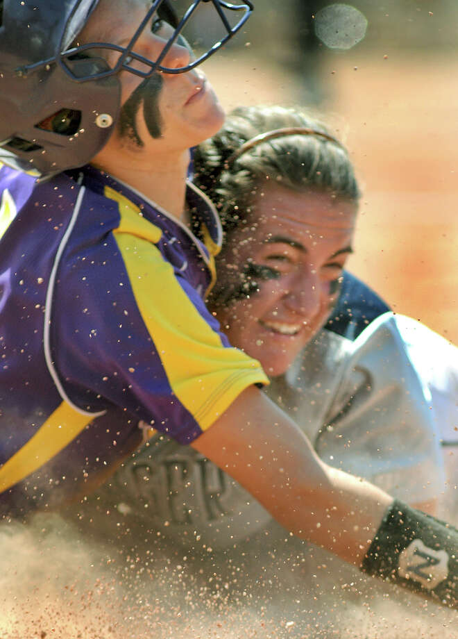 Montgomery senior catcher Cali Lanphear, left, gets tagged out at first base by Smithson Valley's Taylor Darilek in the bottom of the 7th inning for the last out of their 4A state softball final at Red & Charline McCombs Field in Austin on Saturday. Photo: Jerry Baker, For The Chronicle