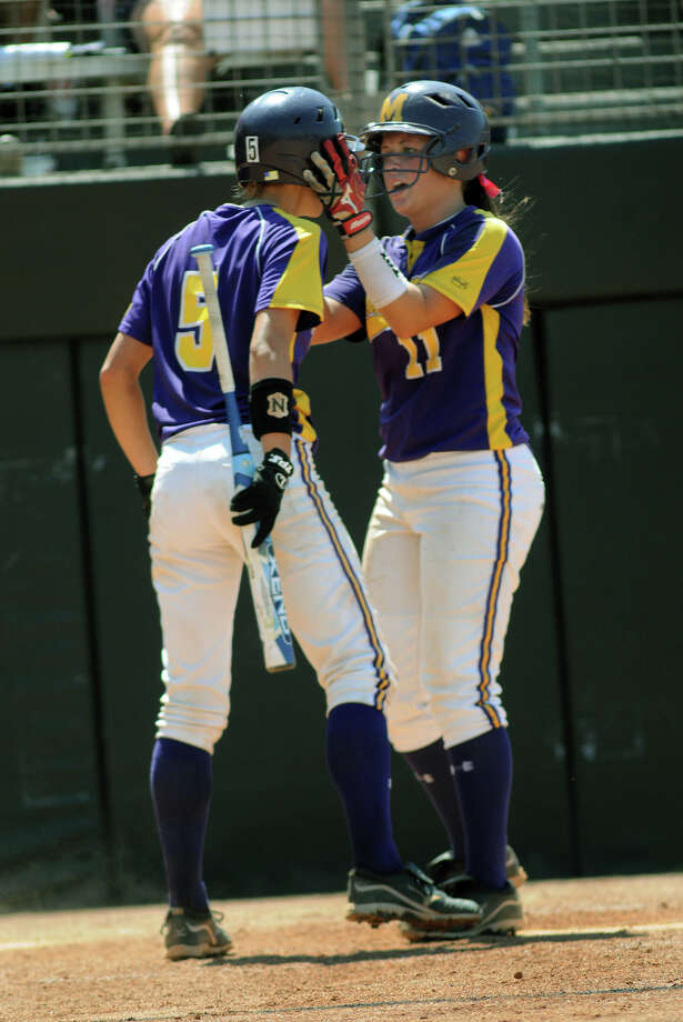 Montgomery senior catcher Cali Lanphear, left, gets pumped up by teammate and junior pitcher Morgan Skinner before Lanphear's at-bat in the bottom of the 7th inning of their 4A state softball final at Red & Charline McCombs Field in Austin on Saturday. Photo: Jerry Baker, For The Chronicle