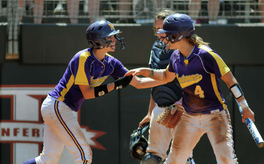 Montgomery senior catcher Cali Lanphear, left, is greeted at home plate by teammate Devon Tunning, a junior shortstop, after Lanphear scored in the bottom of the 6th inning against Smithson Valley during their 4A state softball final at Red & Charline McCombs Field in Austin on Saturday. Photo: Jerry Baker, For The Chronicle