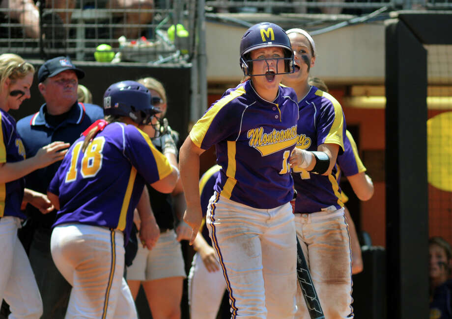 Montgomery junior pitcher Morgan Skinner, center, gets fired up during the Lady Bear's bottom of the 6th inning rally against Smithson Valley during their 4A state softball final at Red & Charline McCombs Field in Austin on Saturday. Photo: Jerry Baker, For The Chronicle