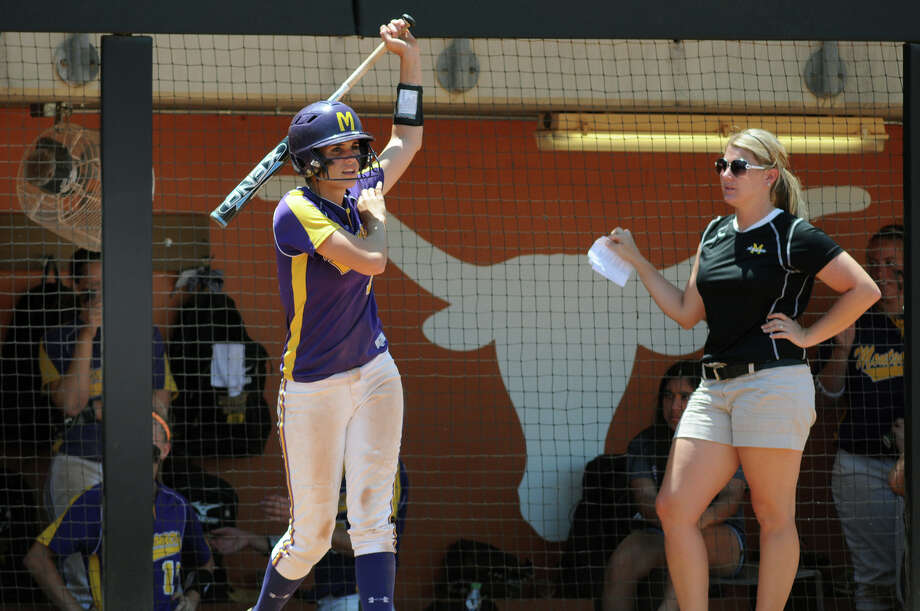 Montgomery freshman third baseman Carly Holder, left, with Asst Coach Rachael Frith, gets ready for her at-bat in the bottom of the 3rd inning against Smithson Valley during their 4A state softball final at Red & Charline McCombs Field in Austin on Saturday. Photo: Jerry Baker, For The Chronicle