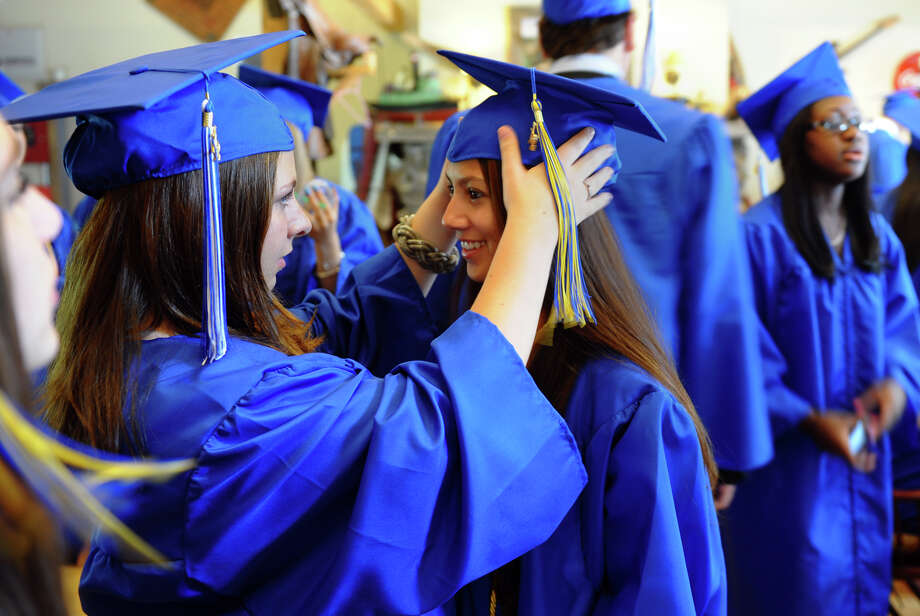 Laura Bilger, left, helps Chelsey Boronski with her cap before the start of Christian Heritage School's 29th Annual Commencement Exercises in Trumbull, Conn. on Saturday June 2, 2012. Photo: Christian Abraham / Connecticut Post