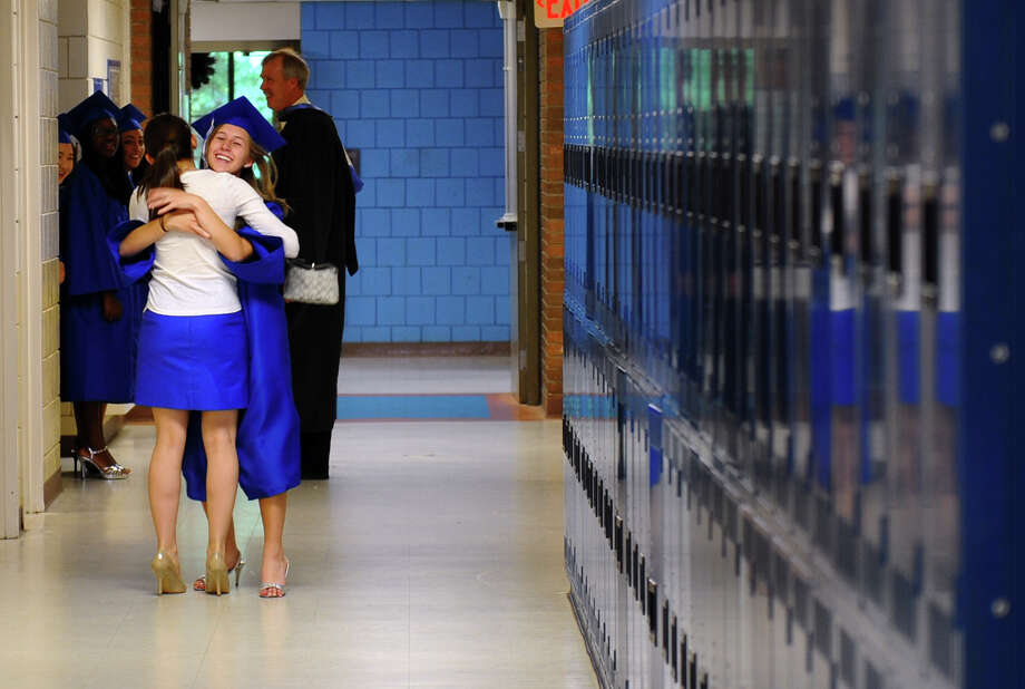 Soon-to-be graduate Carolyn Downs receives a hug from her sister Judith before the start of Christian Heritage School's 29th Annual Commencement Exercises in Trumbull, Conn. on Saturday June 2, 2012. Photo: Christian Abraham / Connecticut Post