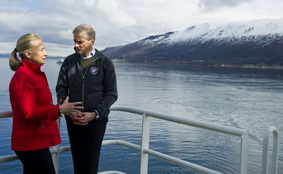 US Secretary of State Hillary Clinton and Norway's Minister of Foreign Affairs Jonas Gahr Stoere (R), talk onboard the Arctic Research Vessel Helmer Hanssen while touring a fjord off of Tromsø, Norway, in the Arctic Circle, June 2, 2012. AFP PHOTO / POOL / Saul LOEBSAUL LOEB/AFP/GettyImages Photo: Saul Loeb, AFP/Getty Images