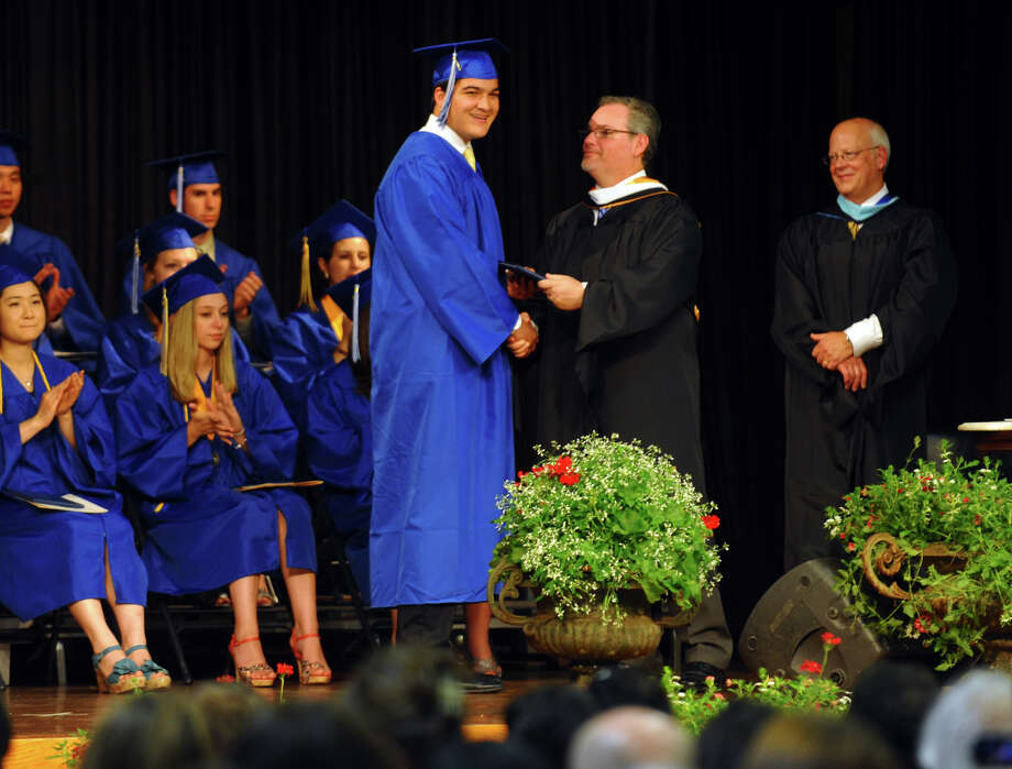 Graduate Taylor DeBlock recieves his diploma, during Christian Heritage School's 29th Annual Commencement Exercises in Trumbull, Conn. on Saturday June 2, 2012. Photo: Christian Abraham / Connecticut Post