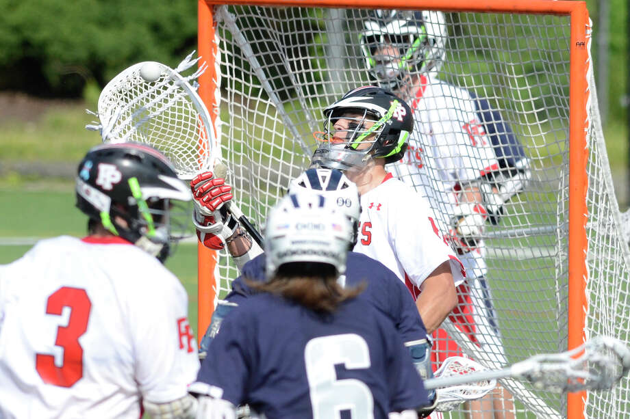 Prep goalie #5 Mike Seelye keeps his eye on the ball as Fairfield Prep hosts Staples High School in varsity boys lacrosse in Fairfield, CT on Sat. June 2, 2012. Photo: Shelley Cryan / Shelley Cryan freelance; Connecticut Post freelance