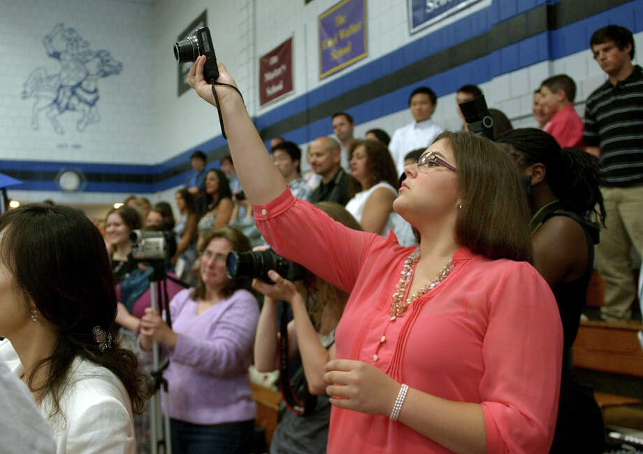 Hannah DeBlock snaps photos during Christian Heritage School's 29th Annual Commencement Exercises in Trumbull, Conn. on Saturday June 2, 2012. Photo: Christian Abraham / Connecticut Post