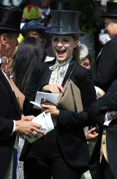 Actress Mischa Barton smiles in the parade ring before The Derby on June 2, 2012 in Epsom, England.
