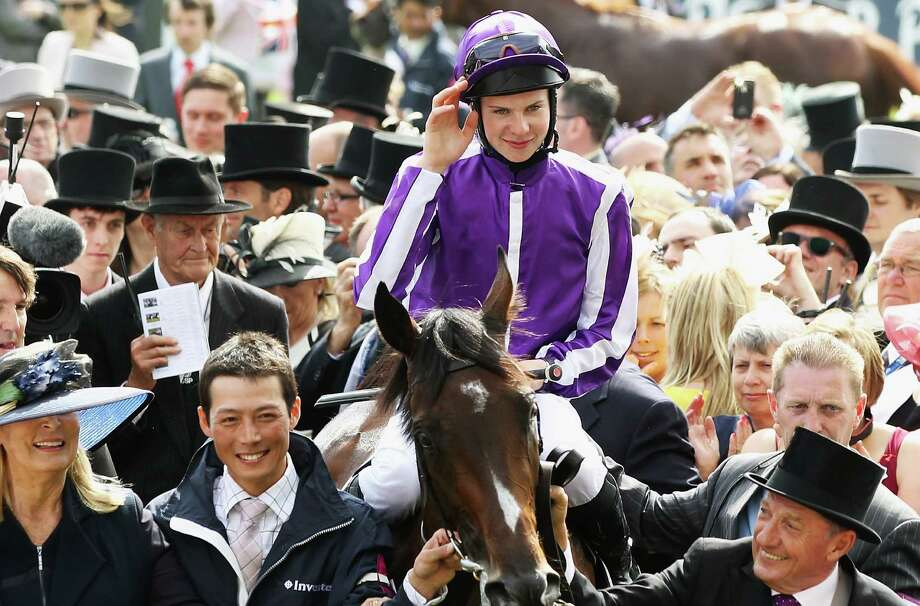 Joesph O'Brien riding Camelot acknowledges the crowd after winning the Investec Derby, at the start of the weekend marking the Queen's Diamond Jubilee celebrations, at Epsom Racecourse on June 2, 2012 in Epsom, England. Photo: Bryn Lennon, Getty Images / 2012 Getty Images