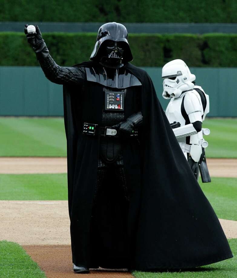 """Darth Vader"" throws the ceremonial first pitch on Star Wars Night before the New York Yankees and the Detroit Tigers baseball game in Detroit, Saturday, June 2, 2012. Photo: Paul Sancya, AP / AP"
