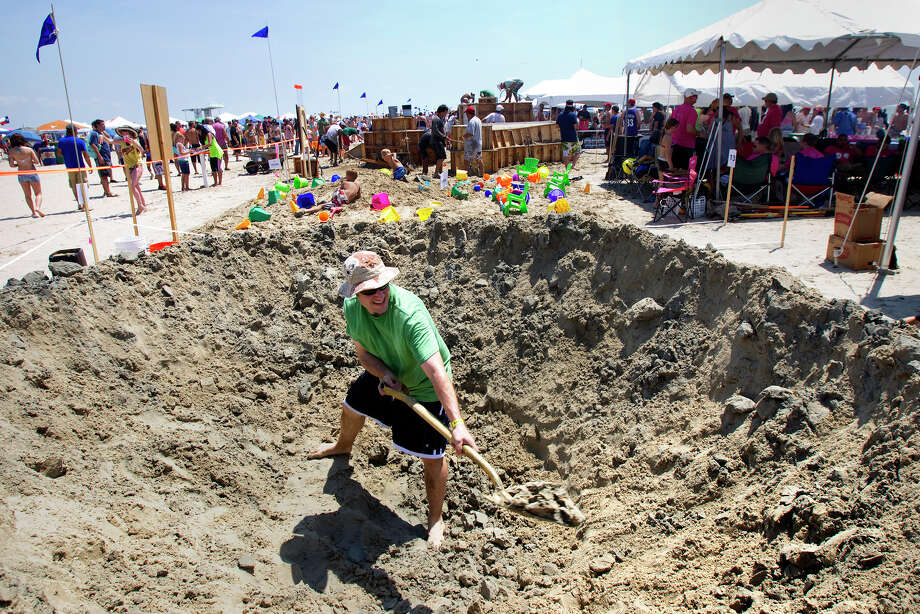 Sean Sachtleben digs out sand for his sculpture resembling a sand blast during the 26th annual AIA SandCastle Competition on Galveston's East Beach Saturday, June 2, 2012, in Galveston. The judging of all sculptures is rated on originality of concept, artistic execution of the concept, technical difficulty, carving technique, and utilization of the site. Photo: Cody Duty, Houston Chronicle / © 2011 Houston Chronicle