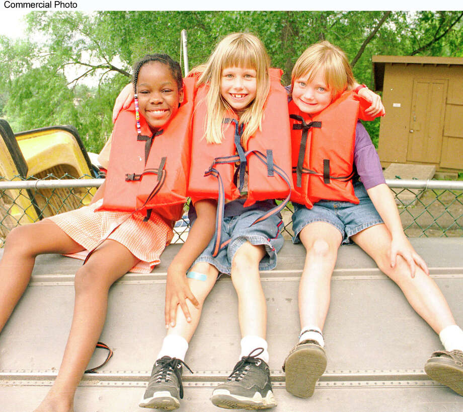 Don't slip and fall, kids, you may not find a nurse at summer camp because of New York's professions laws. Here, three campers at a Salvation Army facility. (PRNewsFoto) / THE SALVATION ARMY