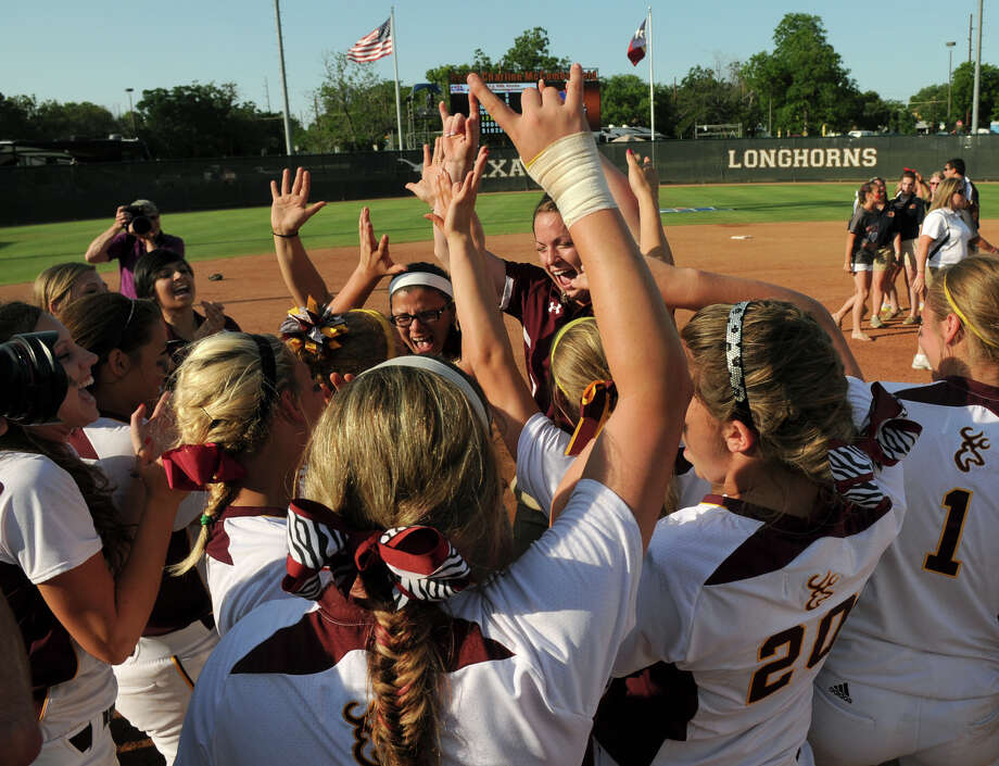 The Deer Park Lady Deers celebrate their state championship after defeating the Klein Collins Tigers in Class 5A softball final at Red & Charline McCombs Field in Austin on Saturday. Photo: Jerry Baker, For The Chronicle