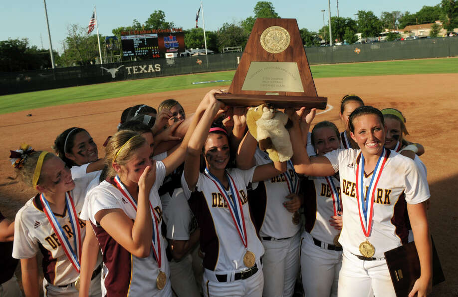 Class 5A State Tournament MVP Kristen Davenport, right, and her Lady Deer teammates hoist their cham