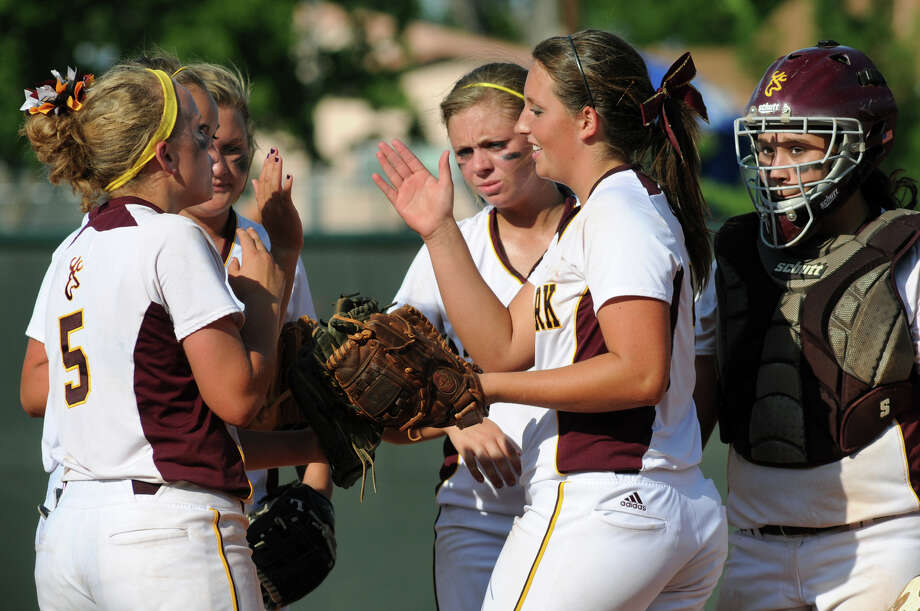 Deer Park senior pitcher Kristen Davenport, center, celebrates a strikeout against  Klein Collins with teammates Rhonda Jarvis, from left, Alexis Garcia, Lexi Fryar, Caitlin Plocheck, and Jo Rivera in the top of the 6th inning during their Class 5A state softball final at Red & Charline McCombs Field in Austin on Saturday. Photo: Jerry Baker, For The Chronicle
