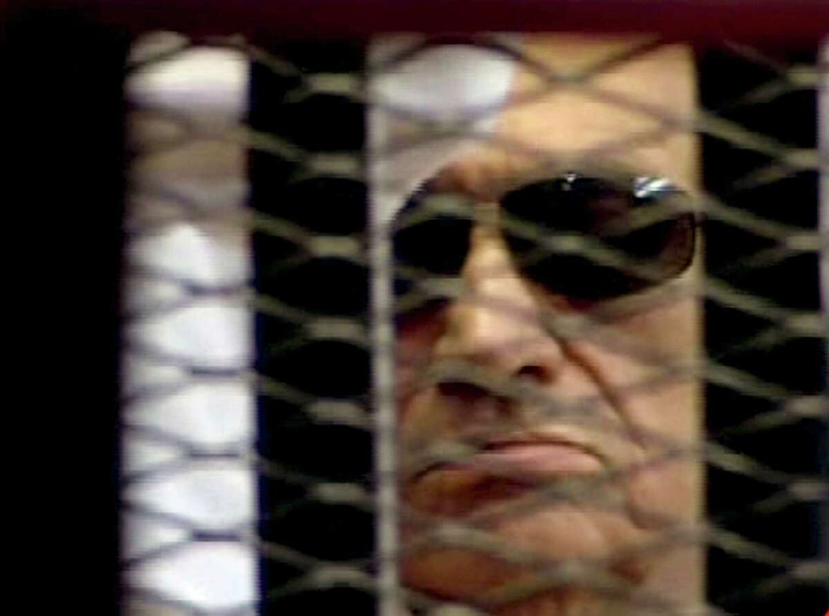 In this video image taken from Egyptian State Television, 84-year-old former Egyptian president Hosni Mubarak is seen in the defendant's cage as a judge reads the verdict in on charges of complicity in the killing of protesters during last year's uprising that forced him from power, in Cairo, Egypt, Saturday, June 2, 2012. Egypt's ex-President Hosni Mubarak has been sentenced to life in prison after a court convicted him on charges of complicity in the killing of protesters during last year's uprising that forced him from power. (AP Photo/Egyptian State TV) EGYPT OUT