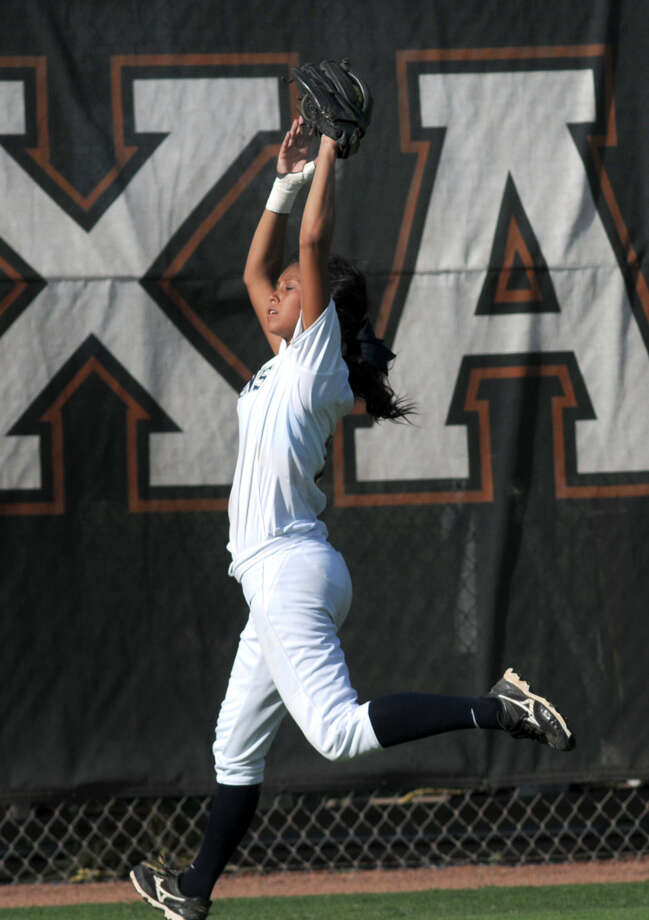 Klein Collins senior centerfielder Kelsey Villasenor makes a catch just short of the fence in the bottom of the 5th inning against Deer Park during their Class 5A state softball final at Red & Charline McCombs Field in austin on Saturday. Photo: Jerry Baker, For The Chronicle