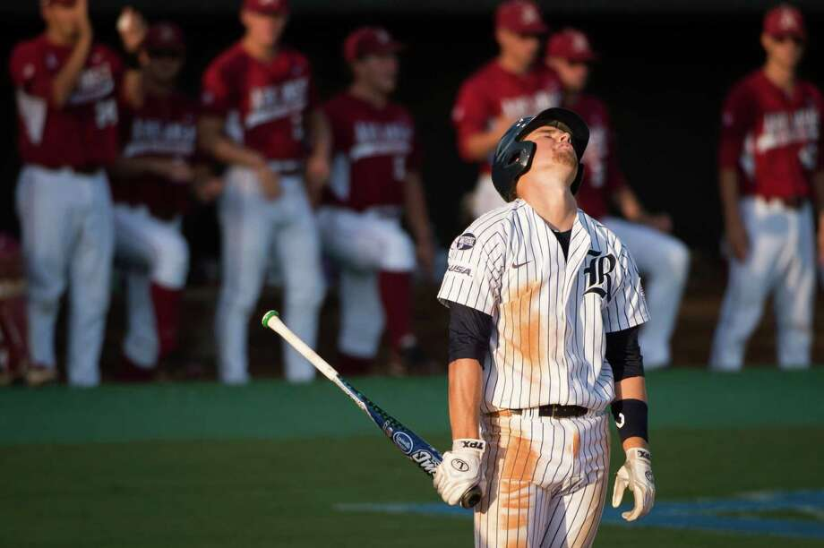 Rice's Shane Hoelscher reacts to a called strike against him during the fifth inning Arkansas in an NCAA college baseball tournament regional game Saturday, June 2, 2012, in Houston. Arkansas won the game 1-0. Photo: Smiley N. Pool, Houston Chronicle / © 2012  Houston Chronicle