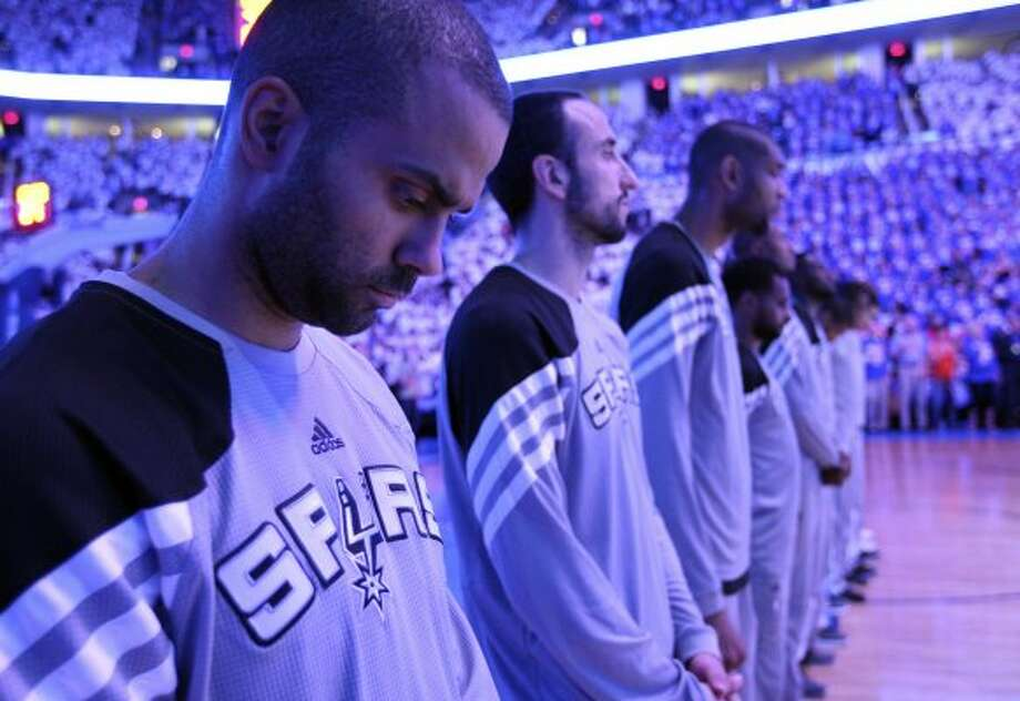 San Antonio Spurs' Tony Parker (9) stands with his team during the pre game ceremonies before the first half of game four of the NBA Western Conference Finals in Oklahoma City, Okla. on Saturday, June 2, 2012. (Edward A. Ornelas / San Antonio Express-News)
