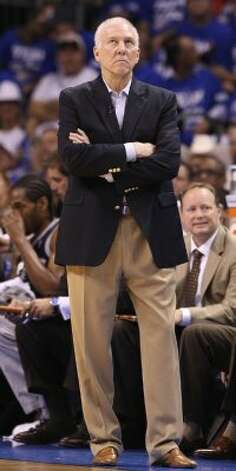 San Antonio Spurs coach Gregg Popovich looks on during the first half of game four of the NBA Western Conference Finals in Oklahoma City, Okla. on Saturday, June 2, 2012. (Edward A. Ornelas / San Antonio Express-News)