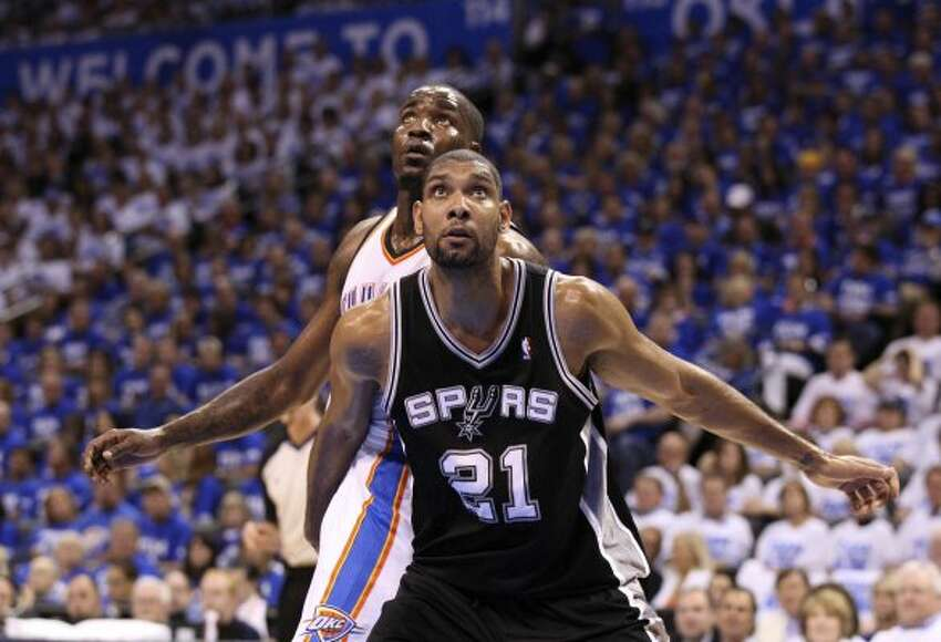 San Antonio Spurs' Tim Duncan (21) posts up against Oklahoma City Thunder's Kendrick Perkins (5) during the first half of game four of the NBA Western Conference Finals in Oklahoma City, Okla. on Saturday, June 2, 2012. (Edward A. Ornelas / San Antonio Express-News)