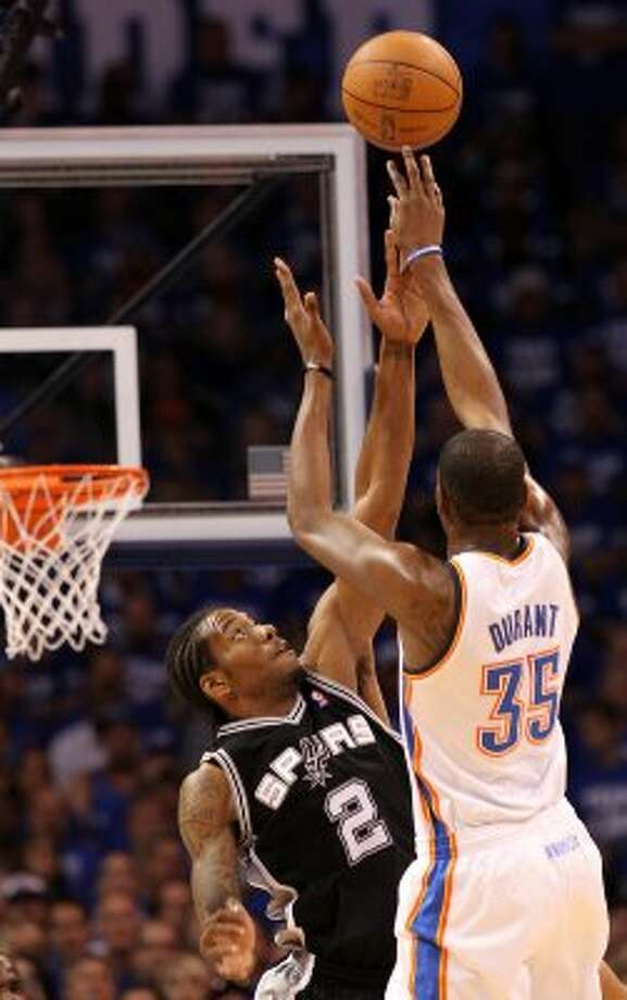 Oklahoma City Thunder's Kevin Durant (35) shoots over San Antonio Spurs' Kawhi Leonard (2) during the first half of game four of the NBA Western Conference Finals in Oklahoma City, Okla. on Saturday, June 2, 2012. (Kin Man Hui / San Antonio Express-News)