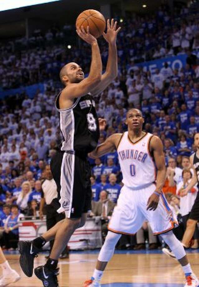 San Antonio Spurs' Tony Parker (9) shoots near Oklahoma City Thunder's Russell Westbrook (0) during the first half of game four of the NBA Western Conference Finals in Oklahoma City, Okla. on Saturday, June 2, 2012. (Kin Man Hui / San Antonio Express-News)