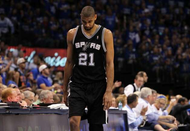 San Antonio Spurs' Tim Duncan (21) walks down the court during the first half of game four of the NBA Western Conference Finals in Oklahoma City, Okla. on Saturday, June 2, 2012. (Kin Man Hui / San Antonio Express-News)