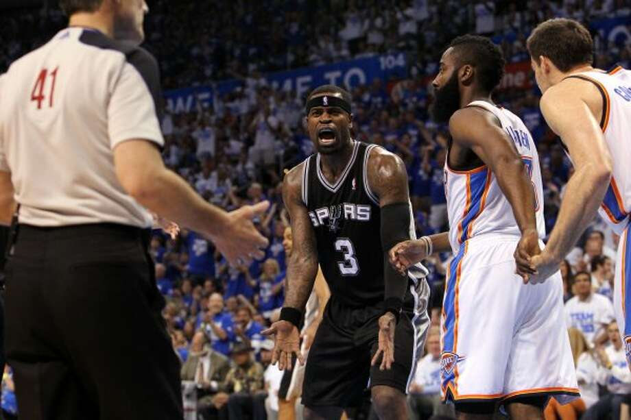 San Antonio Spurs' Stephen Jackson (3) reacts to a call near official Ken Mauer during the first half of game four of the NBA Western Conference Finals in Oklahoma City, Okla. on Saturday, June 2, 2012. (Kin Man Hui / San Antonio Express-News)