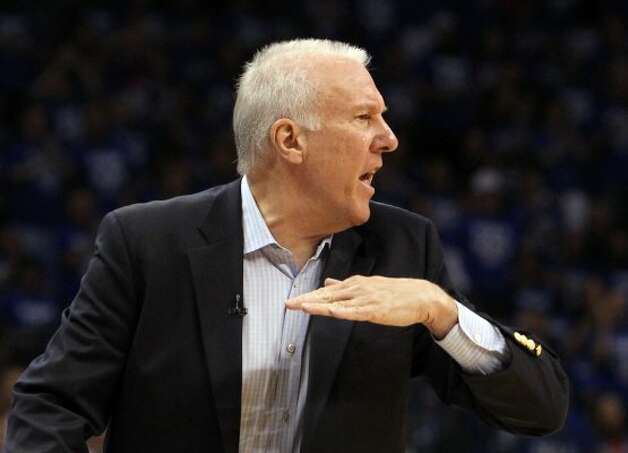 San Antonio Spurs coach Gregg Popovich gestures during the first half of game four of the NBA Western Conference Finals in Oklahoma City, Okla. on Saturday, June 2, 2012. (Kin Man Hui / San Antonio Express-News)