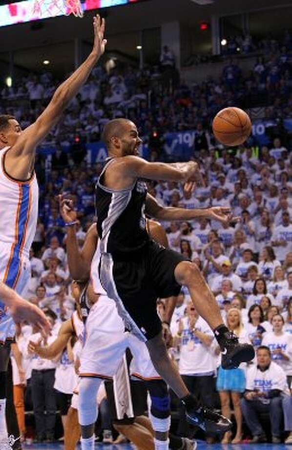 San Antonio Spurs' Tony Parker (9) passes during the first half of game four of the NBA Western Conference Finals in Oklahoma City, Okla. on Saturday, June 2, 2012. (Kin Man Hui / San Antonio Express-News)