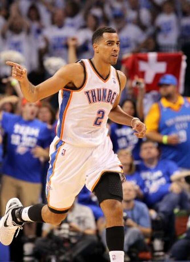 Oklahoma City Thunder's Thabo Sefolosha (2) points after a basket during the first half of game four of the NBA Western Conference Finals in Oklahoma City, Okla. on Saturday, June 2, 2012. (Kin Man Hui / San Antonio Express-News)