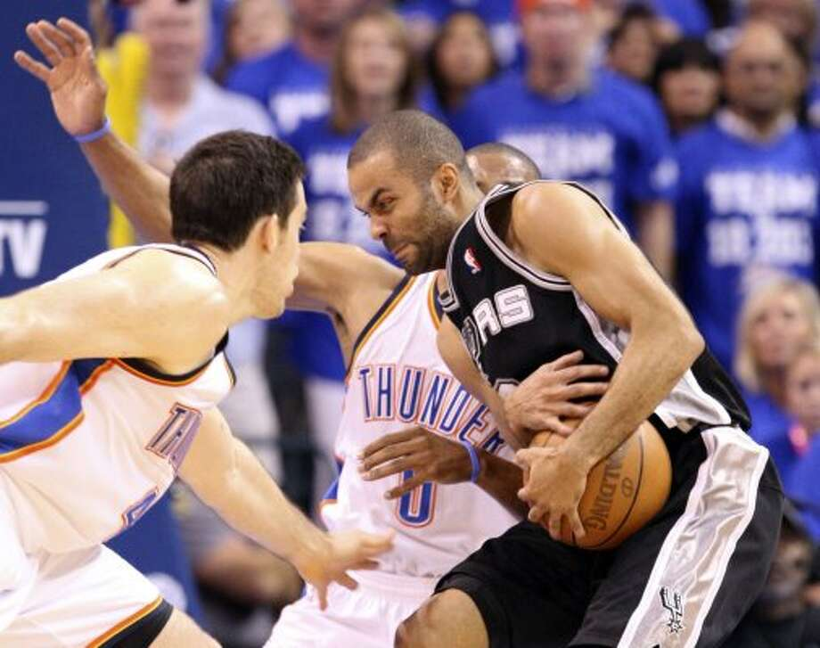 San Antonio Spurs' Tony Parker (9) has trouble controlling the ball near Oklahoma City Thunder's Nick Collison (4) during the first half of game four of the NBA Western Conference Finals in Oklahoma City, Okla. on Saturday, June 2, 2012. (Edward A. Ornelas / San Antonio Express-News)