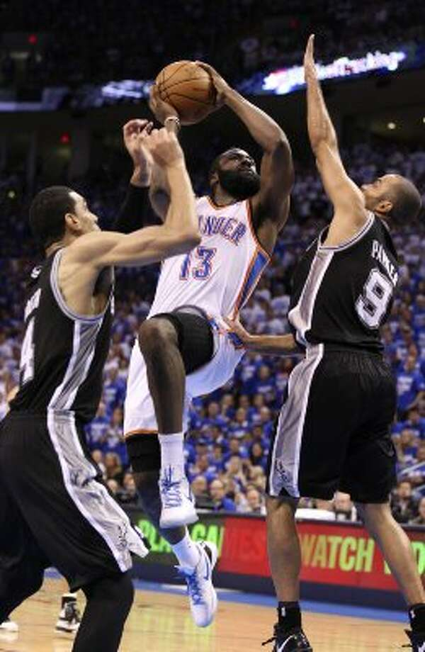 Oklahoma City Thunder's James Harden (13) shoots against San Antonio Spurs' Danny Green (4) and San Antonio Spurs' Tony Parker (9) during the first half of game four of the NBA Western Conference Finals in Oklahoma City, Okla. on Saturday, June 2, 2012. (Edward A. Ornelas / San Antonio Express-News)