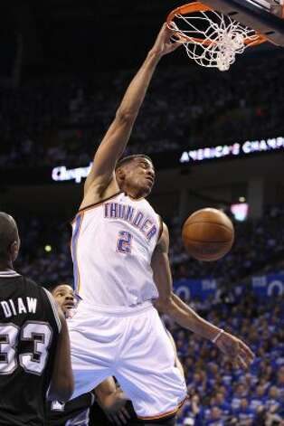 Oklahoma City Thunder's Thabo Sefolosha (2) dunks near San Antonio Spurs' Boris Diaw (33) during the first half of game four of the NBA Western Conference Finals in Oklahoma City, Okla. on Saturday, June 2, 2012. (Edward A. Ornelas / San Antonio Express-News)