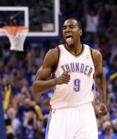 Oklahoma City Thunder's Serge Ibaka (9) reacts after a basket during the first half of game four of the NBA Western Conference Finals in Oklahoma City, Okla. on Saturday, June 2, 2012. (Edward A. Ornelas / San Antonio Express-News)