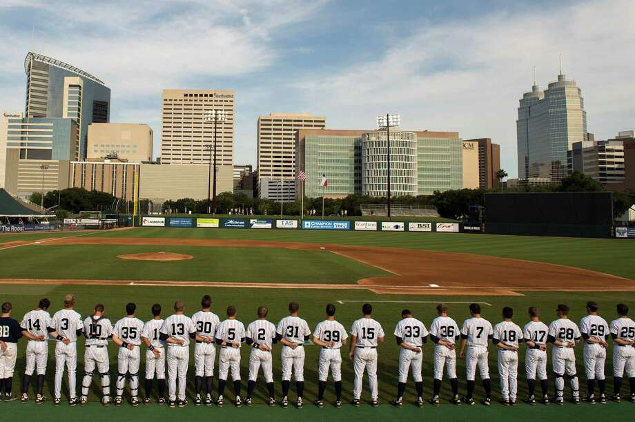 Rice players stand for the national anthem before facing Arkansas in an NCAA college baseball tournament regional game Saturday, June 2, 2012, in Houston. Arkansas won the game 1-0. Photo: Smiley N. Pool, Houston Chronicle / © 2012  Houston Chronicle