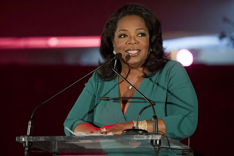 """FILE - In this March 9, 2012 file photo, Oprah Winfrey accepts her DVF Lifetime Leadership Award at The Third Annual DVF Awards held at the United Nations in New York. """"Oprah's Book Club 2.0,"""" a joint project of Winfrey's OWN network and her """"O"""" magazine, begins Monday with Cheryl Strayed's popular memoir """"Wild."""" Along with the traditional paper version of the book, special e-editions will be made available that include Winfrey's comments and a reader's guide.  (AP Photo/Charles Sykes, File) Photo: Charles Sykes, Associated Press"""