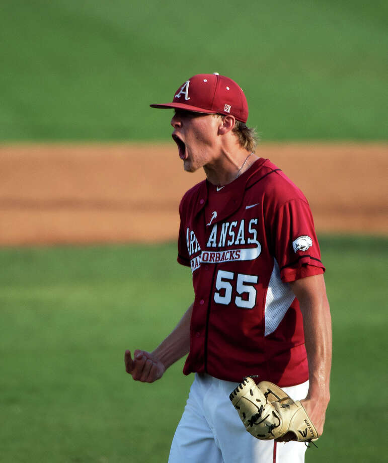 Arkansas pitcher Ryne Stanek celebrates after recording the final out of the fourth inning against Rice in an NCAA college baseball tournament regional game Saturday, June 2, 2012, in Houston. Arkansas won the game 1-0. Photo: Smiley N. Pool, Houston Chronicle / © 2012  Houston Chronicle