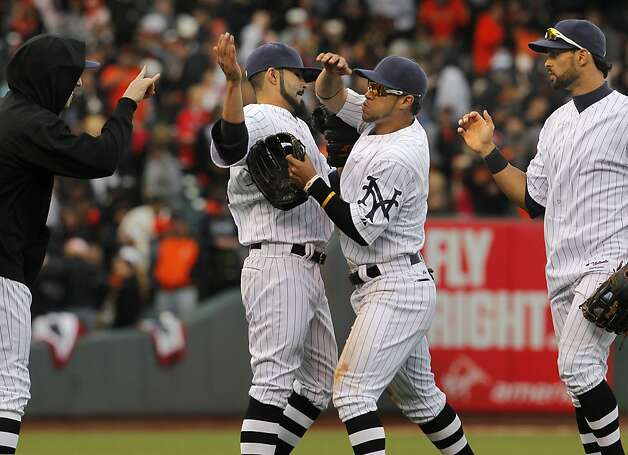 Tim Lincecum, Sergio Romo, Gregor Blanco and Angel Pagan celebrate a win by the transplanted New York base ball Giants. Photo: Michael Macor, The Chronicle